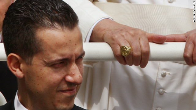 Pope Benedict XVI's former butler Paolo Gabriele pictured sitting below the pontiff on June 6, 2007.