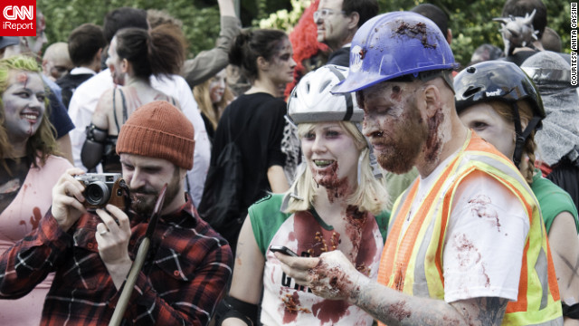 Even the undead have to text sometimes. iReporter Anita Cassini shot photos of an October 2011 zombie walk in New York.