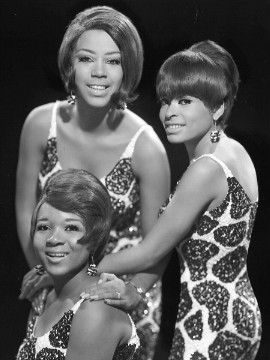 "They may not be as well known as some of their former label mates, but The Marvelettes helped make history. The quartet gave the Motown/Tamla label its first official No. 1 Hot 100 hit in 1961 with the single ""Please Mr. Postman"" which included Marvin Gaye on drums. Their songs have been covered by the likes of Blondie and Bonnie Raitt."