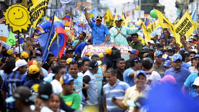 Capriles greets supporters during a campaign rally in Puerto Ayacucho on Monday.