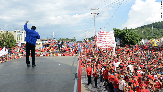 Chavez waves to supporters on Tuesday.