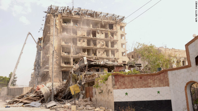 Three car bombs destroyed the area around a military officers' club and a hotel in Aleppo, Syria, on Wednesday. At least 40 people were killed and 90 wounded, most of them soldiers, a monitoring group said.