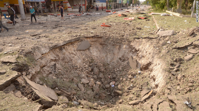 Car bomb explosions on Wednesday left a crater in the ground.