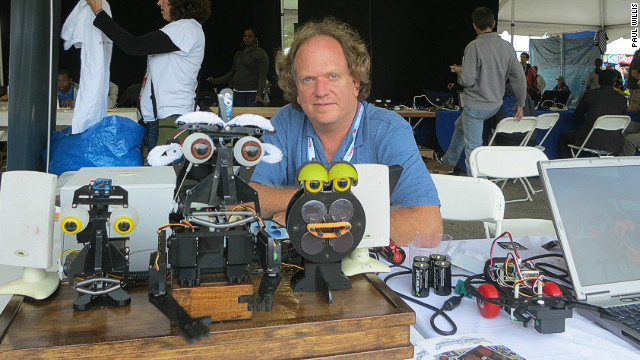 Brian Patton from Trenton, New Jersey brought a singing robot to the recent Maker Faire in New York. With eyebrows made from pipe cleaners and eye's borrowed from a doll, the robot is synched to a computer program that Patton devised and allows him to control facial expressions.<br/><br/>