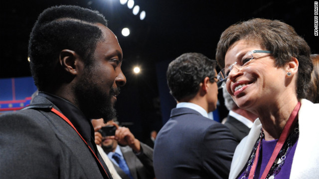 Rapper Will.i.am, left, speaks with Jarrett before the debate on Wednesday. <a href='http://www.cnn.com/2012/10/03/politics/gallery/10-3-debate-prep/index.html'>View behind-the-scenes photos of debate preparations.</a>