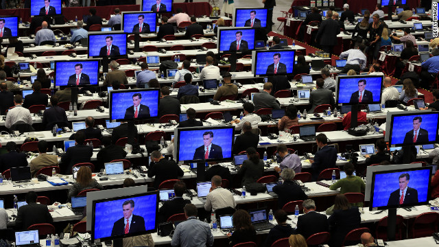 Reporters watch the final minutes of the debate between Romney and Obama in Denver on Wednesday, October 3. The first of four debates for the 2012 election -- three presidential and one vice-presidential -- was moderated by Jim Lehrer of PBS.