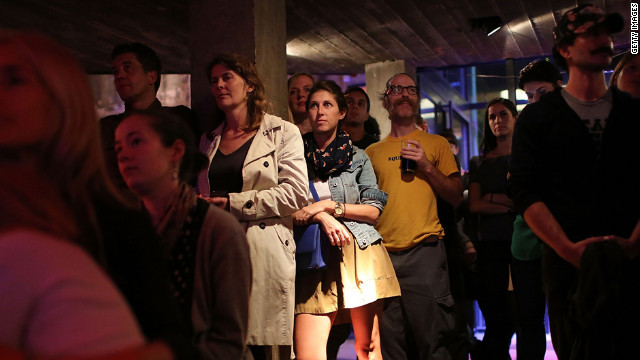 People watch the debate at Galapagos Art Space in Brooklyn, New York.