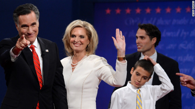 Romney stands with his wife, Ann, and family following the first presidential debate.