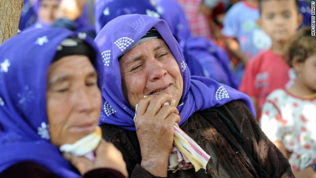 Local women mourn victims of the Syrian mortar attack on Thursday.