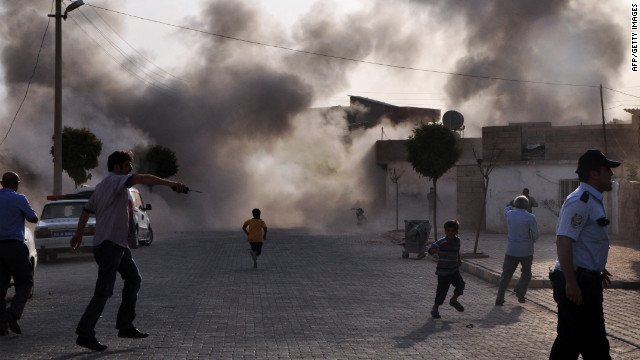 Smoke rises after the explosion on Wednesday. <a href='http://www.cnn.com/2012/07/16/middleeast/gallery/syria-unrest/index.html' target='_blank'>See photos of Syria's civil fighting.</a>