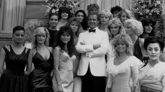 Roger Moore poses with the Bond Girls from the film &quot;View to a Kill&quot; in 1984.