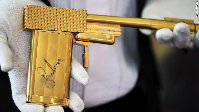 A replica gun from the 1974 James Bond movie, &quot;The Man with the Golden Gun,&quot; autographed by Roger Moore.