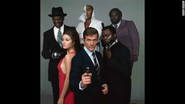 The cast of &quot;Live and Let Die,&quot; in 1973, from front center, clockwise, Roger Moore as Bond, Jane Seymour as Solitaire, Julius Harris as Tee Hee, Geoffrey Holder as Baron Samedi, Earl Jolly Brown as Whisper and Yaphet Kotto as Kananga. 