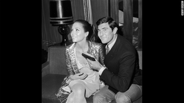 "George Lazenby with actress Diana Rigg, who played Teresa di Vicenzo, during a press conference for ""On Her Majesty's Secret Service"" in London, in October 1968."