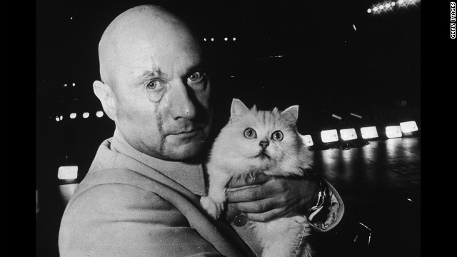  Donald Pleasence in character as Ernst Stavro Blofeld, holding a white cat on the set of &quot;You Only Live Twice,&quot; in November 1966. 