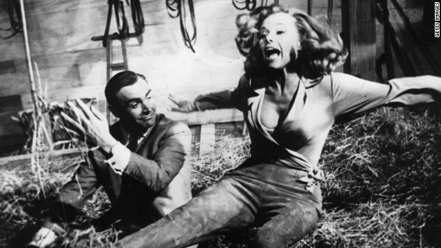 Sean Connery's Bond is up to his tricks with actress Honor Blackman as Pussy Galore during the filming of &quot;Goldfinger&quot; in 1964.