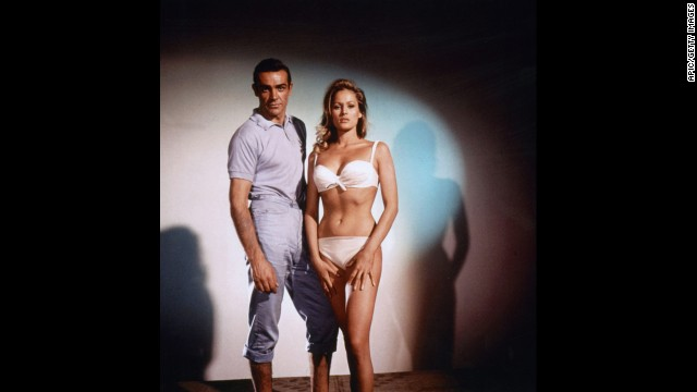 Sean Connery plays James Bond with Ursula Andress as Honey Ryder in 1962's &quot;Dr. No.&quot; Friday, October 5, is &quot;International Bond Day&quot; and marks 50 years of Bond films, starting with &quot;Dr. No.&quot; MGM is marking the celebration by releasing&lt;a href='http://www.007.com/' target='_blank'&gt; a 23-disc &quot;Bond 50&quot; collection&lt;/a&gt; of the films on Blu-ray. Click through to see highlights of the character's career, including the Bond girls and villians. 