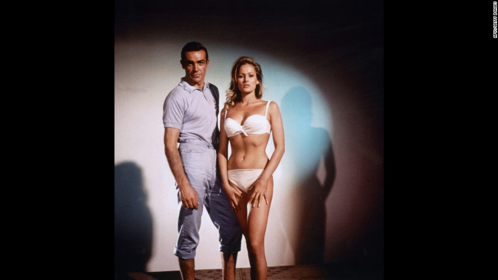 "Sean Connery plays James Bond with Ursula Andress as Honey Ryder in 1962's ""Dr. No."" Friday, October 5, is ""International Bond Day"" and marks 50 years of Bond films, starting with ""Dr. No."" MGM is marking the celebration by releasing<a href='http://www.007.com/' target='_blank'> a 23-disc ""Bond 50"" collection</a> of the films on Blu-ray. Click through to see highlights of the character's career, including the Bond girls and villians."