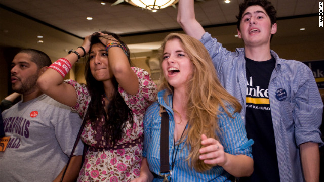 College students in Northfield, Minnesota, react on November 4, 2008, as it's announced Barack Obama was elected president.