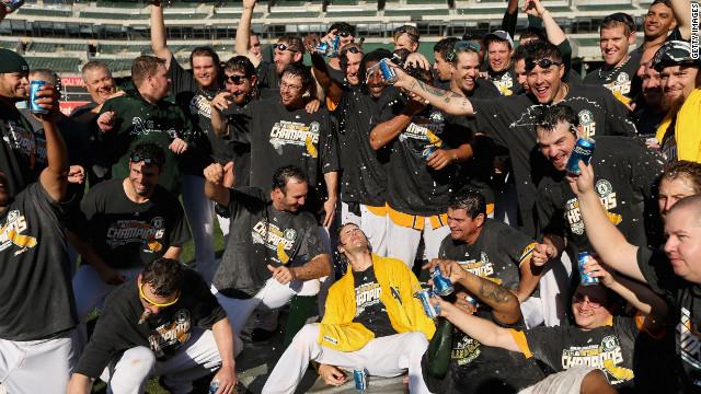 The Oakland Athletics celebrated after they beat the Texas Rangers to win the American League West Division title on Wednesday.