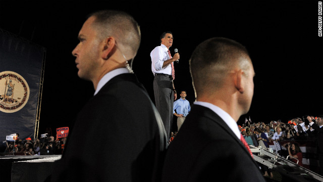 Romney speaks in Fishersville, Virginia, as Secret Service members keep guard on Thursday, October 4. A day after the first presidential debate in Denver, Romney headed to Virginia to continue campaigning.