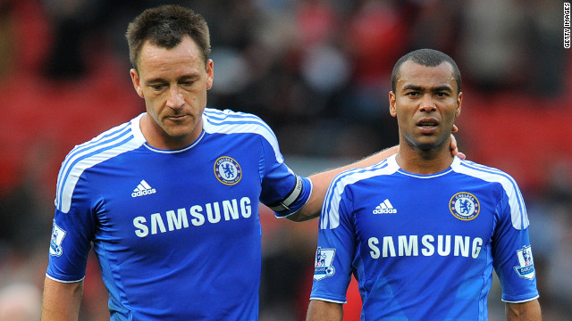 Ashley Cole (right) may incur an FA sanction after his outburst in response to a report which highlighted 'inconsistencies' in the evidence he gave in support of Chelsea team mate John Terry (left) following his racial comments towards Anton Ferdinand last year