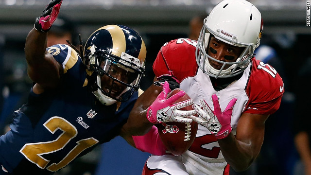 Janoris Jenkins of the St. Louis Rams breaks up a pass intended for Andre Roberts of the Arizona Cardinals.