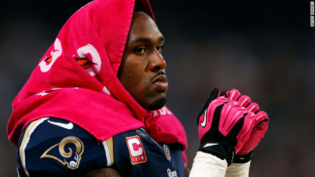 Steven Jackson of the St. Louis Rams watches Thursday's game against the Arizona Cardinals from the sidelines at the Edward Jones Dome.