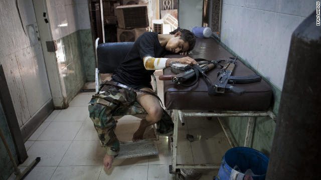 An injured Free Syrian Army fighter rests after receiving treatment at Dar al Shifa hospital in Aleppo on Thursday, October 4.