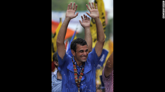 Capriles greets supporters during a Thursday's campaign rally in San Carlos.