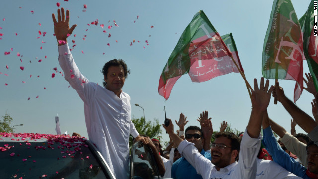Imran Khan, a Pakistan cricketer-turned-politician, waves to supporters at the start of the rally.
