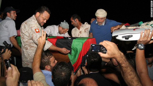 Friends and relatives of Omran Ben Shabaan offload his coffin upon its arrival at the Misrata International Airport on September 25, 2012 in Misrata.