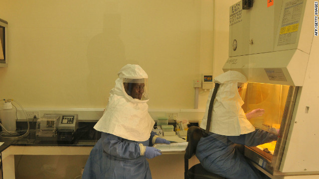 Researchers work at U.S. Center for Disease Control and Prevention on August 2, 2012, after Ebola outbreak in Uganda.