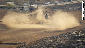 An Israeli army helicopter searches for the remains of the downed drone in the northern Negev. 