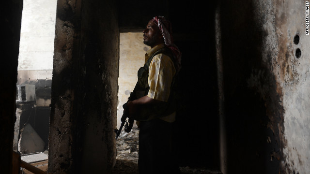 A Syrian rebel takes position during clashes with government forces in Aleppo on Friday.
