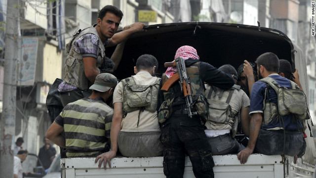 Syrian rebels patrol a neighborhood in Aleppo on Friday, October 5.