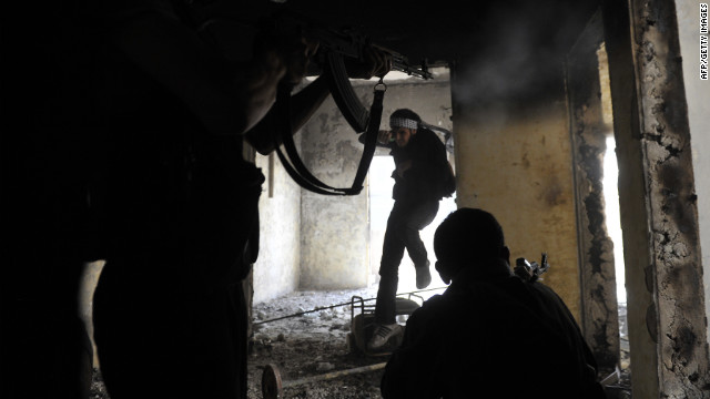 Syrian rebels take up positions inside a building during clashes with government forces in Aleppo on Saturday, October 6. <a href='http://www.cnn.com/SPECIALS/world/photography/index.html' target='_blank'>See more of CNN's best photography.</a>