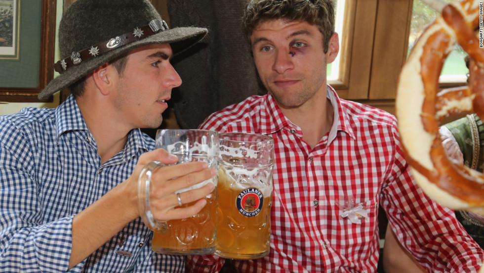 Philipp Lahm, left, of the German football team Bayern Munchen attends the Oktoberfest beer festival with his teammate Thomas Mueller in Munich, Germany, on Sunday, October 7, the last day of the world's biggest beer festival. <a href='http://www.cnn.com/SPECIALS/world/photography/index.html'>See more of CNN's best photography.</a>