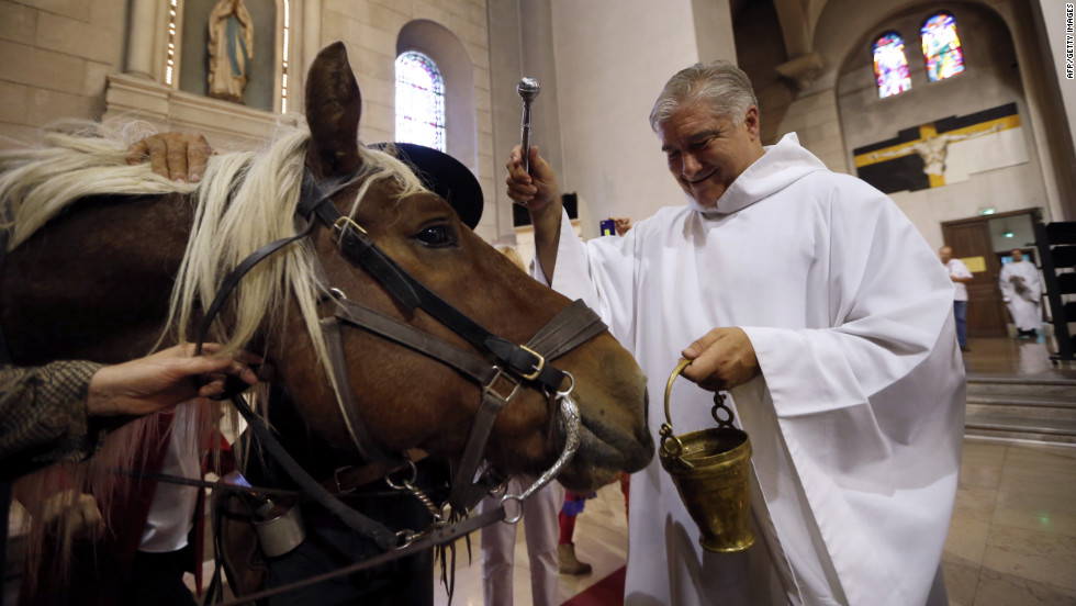 Gil Florini, priest of St.-Pierre-d'Arene Church, blesses a horse during a Mass dedicated to animals to honor the feast of St. Francis of Assisi on Sunday, October 7, in Nice, France. Catholic churches around the world hold annual blessings of pets on the feast day of Francis, the patron saint of animals. &lt;a href='http://www.cnn.com/SPECIALS/world/photography/index.html' target='_blank'&gt;Check out more of CNN's best photography.&lt;/a&gt;