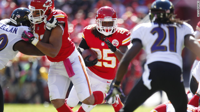 Jamaal Charles of the Kansas City Chiefs powers through the Baltimore Ravens defense.