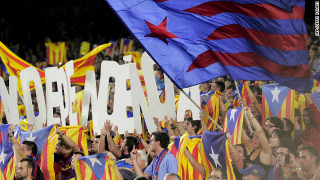 Barcelona fans hold letters forming the word 'Independencia' and wave Catalan 'Estelada' independence flags in the match against Real Madrid. 
