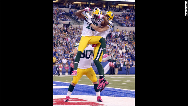 No. 18 Randall Cobb of the Green Bay Packers celebrates after scoring a touchdown Sunday against the Indianapolis Colts.