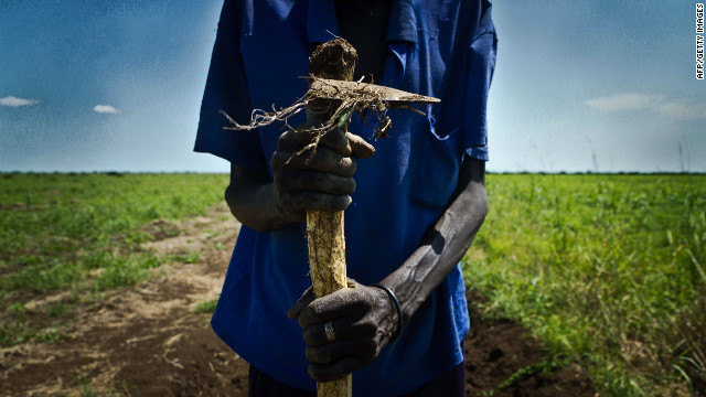 A South Sudanese farmer holds a plow in Renk, a city near the Sudan border. The two nations are hashing out border issues.