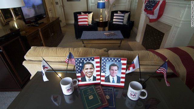 Framed photos of Barack Obama and Mitt Romney decorate a table in a politically inspired suite at the Mayflower Hotel in Washington.