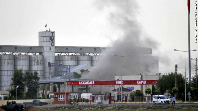 Smoke rises at a border gate in Akcakale, Turkey, near the Syrian border on Sunday, October 7, after a shell fired from Syria. Turkey fired on Syrian government targets in response. No was injured in Sunday's shelling, a witness said. Akcakale is the same town where five Turks were killed last week in another cross-border incident. <a href='http://www.cnn.com/2012/07/16/middleeast/gallery/syria-unrest/index.html' target='_blank'>See photos of Syria's internal violence.</a>