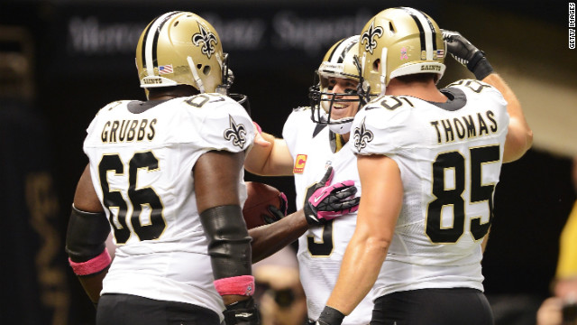 Brees celebrates setting an NFL reocrd with his teammates Sunday.
