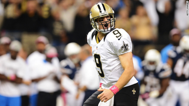 Brees celebrates his record-breaking touchdown pass in the first quarter against the Chargers on Sunday. The Saints quarterback threw a touchdown pass in his 48th consecutive NFL game, breaking the mark set by Johnny Unitas a half-century ago.