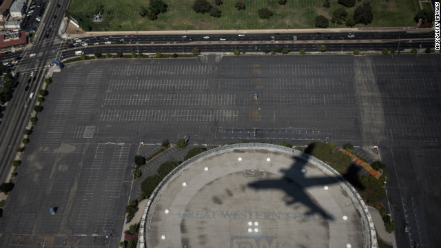 Air Force One leaves a shadow as it passes over the Forum on approach to Los Angeles International Airport on Sunday.