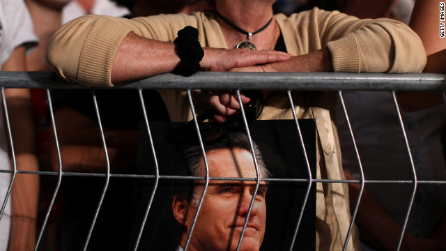 A supporter holds a photograph of Romney in Apopka on Saturday.