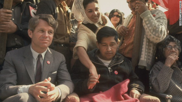 Robert F. Kennedy sits next to Chavez, very weak after a prolonged hunger strike, in March 1968 during a rally in support of the United Farm Workers in Delano, California.